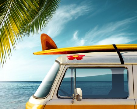 Photo for Detail of a vintage van in the beach with a surfboard on the roof - Royalty Free Image