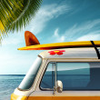 Detail of a vintage van in the beach with a surfbo...