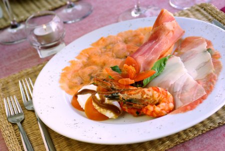 Photo for Italian appetizer with smoked salmon, ham and shrimps - Royalty Free Image