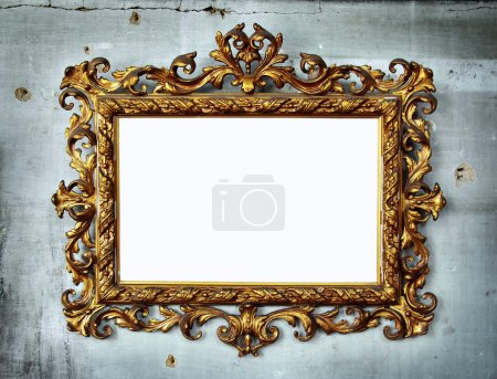 Photo for Beautiful golden baroque frame hanged in an old wall with holes and cracks - Royalty Free Image