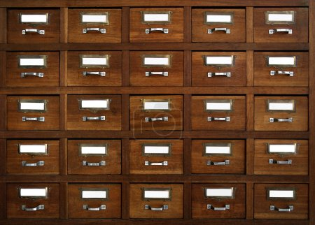 Photo for Rows of little drawers with white empty tags in an old furniture module - Royalty Free Image