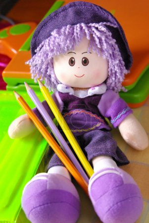 Doll and Pencils