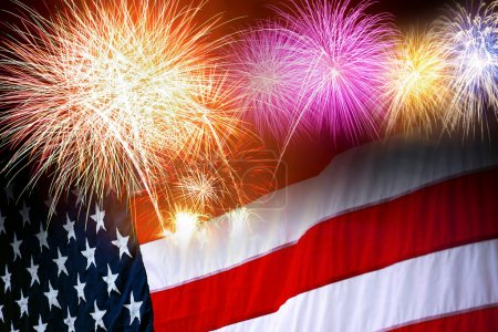 Photo for The American flag and fireworks in the independence day celebration - Royalty Free Image