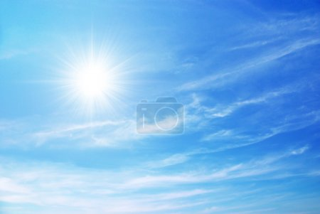 Photo for Bright blue sky with sun shining and some clouds - Royalty Free Image