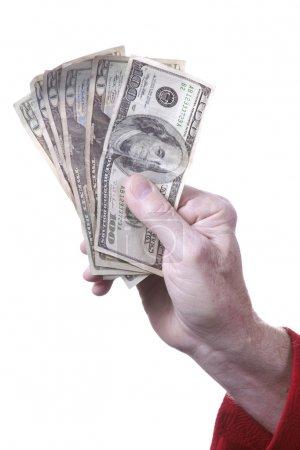 Photo pour Un homme vêtu d'un manteau de sport rouge remettant de l'argent à quelqu'un sur fond blanc dans le format vertical . - image libre de droit