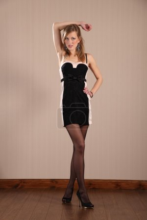 Long legs model poses in short dress