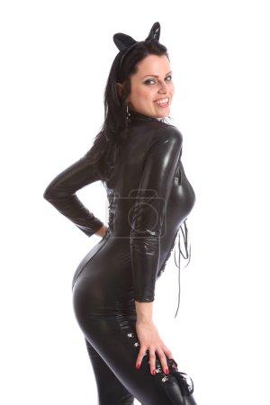 Hermosa chica en piel negra traje de mujer gato apretado