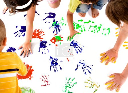 Photo for Kids making colourful hand prints on white copy space - Royalty Free Image