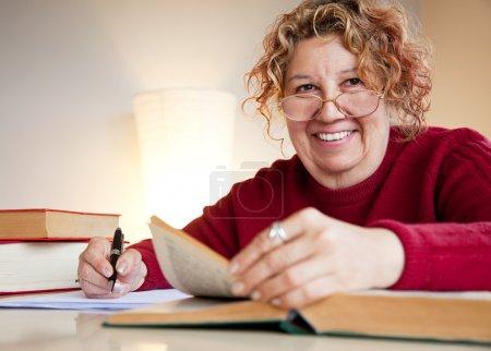 Professor jew over books smiling