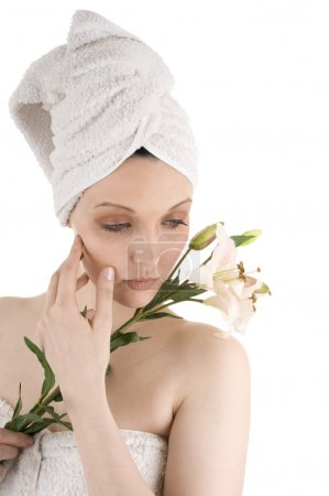 Photo for Beautiful female with towel and flowers - Royalty Free Image