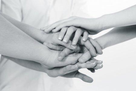 Photo pour L'équipe des activités mis mains ensemble - image libre de droit