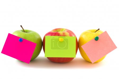 Three apples with colourfull memo stickers isolate...