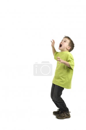 Photo for This boy is very scared. Against a white background. - Royalty Free Image