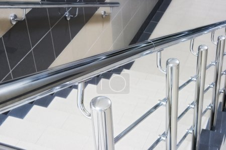 Staircase with metallic stair railing