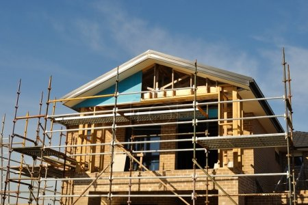 House front in scaffolds