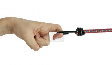 Hand holding elastic rope