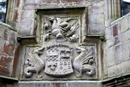 A family coat of arms carved from stone in the cou...