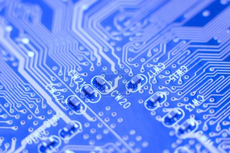 Photo pour Carte mère macro - bleu circuit imprimé avec petit microschemes - image libre de droit