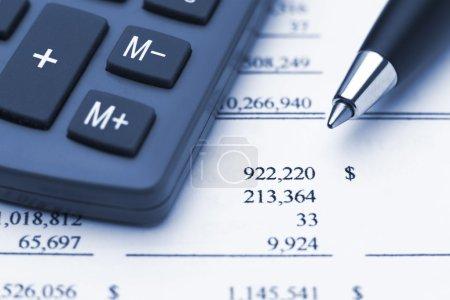 Calculator pen and financial report
