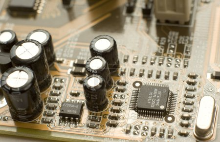 Photo for Macro of black capacitors and microchips on circuitboard - Royalty Free Image