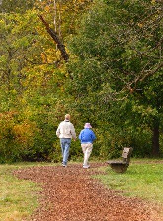 Senior citizen couple walking on path