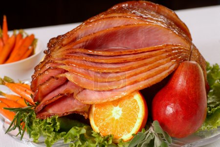 Photo for A spiral cut honey glazed Easter ham with fruit and carrots - Royalty Free Image