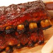 Two slabs of delicious BBQ spare ribs with dipping...