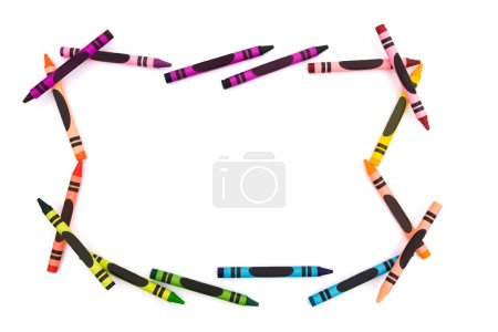 Photo pour Une bordure pleine de crayons isolés sur du blanc avec de l'espace pour votre texte, un fond d'école - image libre de droit