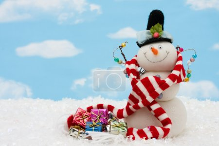 Photo for Snowman wearing scarf on blue sky background, merry Christmas - Royalty Free Image