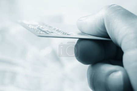 Photo for Hand holding credit card for electronic transaction - Royalty Free Image