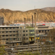 Chinese factory and chimneys apartments in front o...