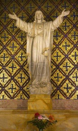 Photo pour Statue de Jésus Fleurs Mission Dolores Saint Francis De Assis Orné Sculpture San Francisco Californie - image libre de droit