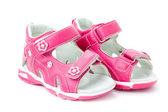 Paio di scarpe bambino su uno sfondo bianco