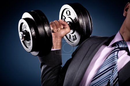 Photo for Suited man holding a heavy barbell - Royalty Free Image