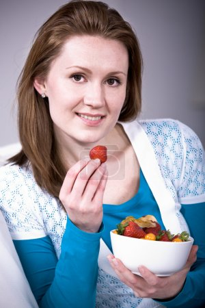 Photo for A young woman with fresh strawberries - Royalty Free Image