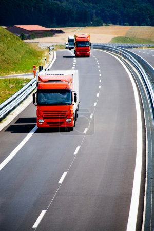 Photo for Two trucks on the road - Royalty Free Image
