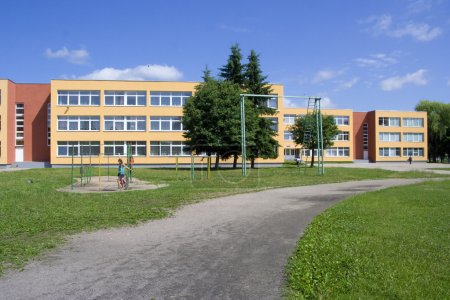 Photo for Exterior view of school building whith playground. - Royalty Free Image