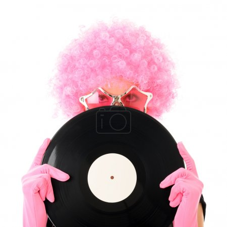 Photo pour Fille drôle tenant disque de vinyle - image libre de droit