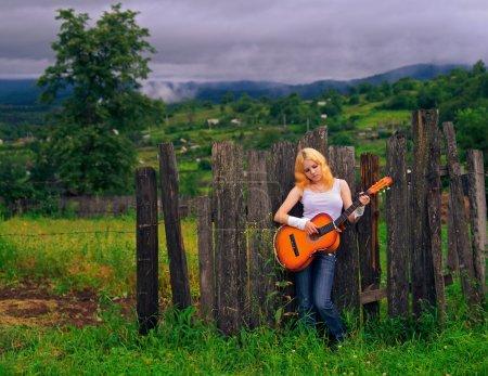 Girl with broken guitar