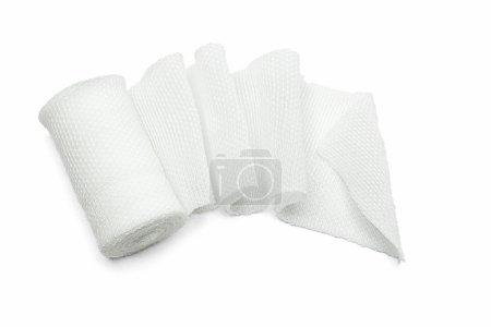 Photo pour Bandage en gaze de coton médical blanc sur fond blanc - image libre de droit