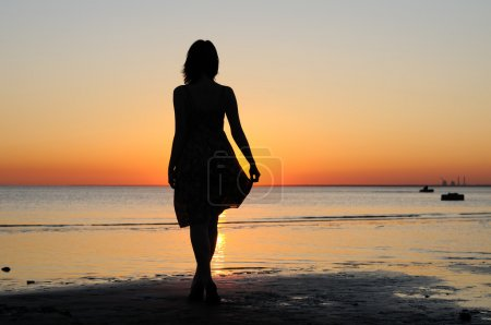 Photo for Portrait of young woman as silhouette by the sea - Royalty Free Image