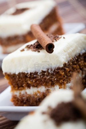 Photo for Delicious pieces of carrot cake with cinnamon stick - Royalty Free Image