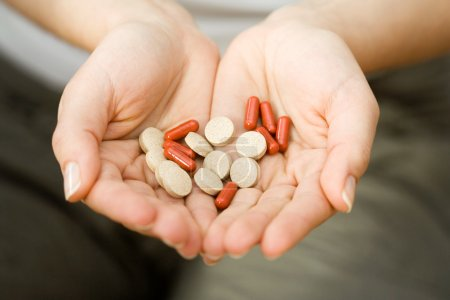 Photo for Woman holding medicines in her hands - Royalty Free Image