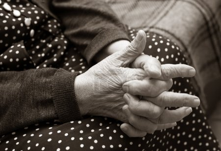 Hands of the elderly woman.