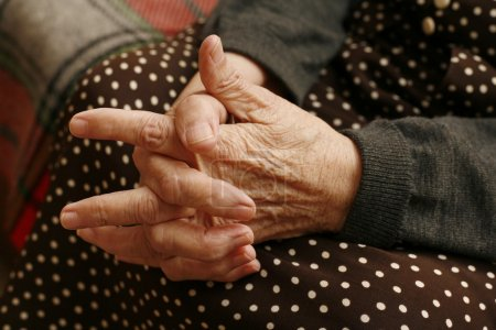 Hands of the elderly woman