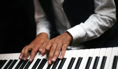 Photo for The image of the piano and man's hands - Royalty Free Image