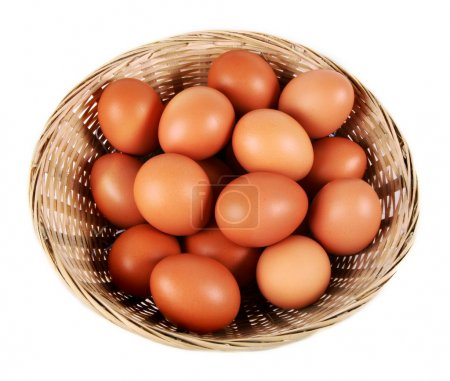 Photo for Eggs in a basket isolated on white - Royalty Free Image