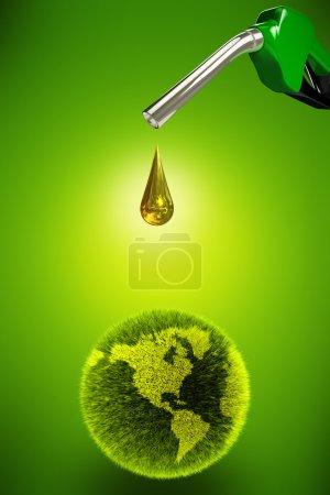 Foto de Bomba de gasolina cae aceite limpio en un planeta verde - Imagen libre de derechos