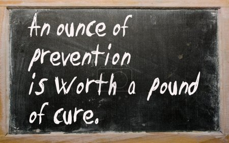 """""""An ounce of prevention is worth a pound of cure"""" written on a b"""