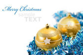 Yellow christmas decorations isolated on white background with c
